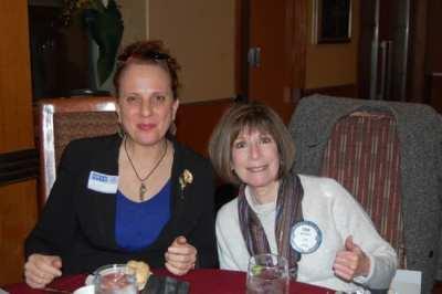 Membership co-chair Toni Kern welcomes guest Nicole Borghi