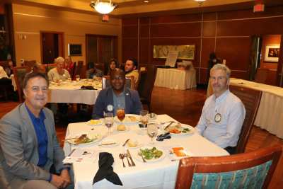Head table guests Dr. Bo Bernhard, Kim Nyoni and PP Jim Kohl
