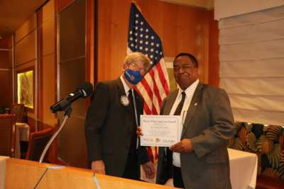 President Whitfield receives a Share What You Can award for a great presentation