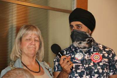 SAA Bhavan Singh brings the mic to 25 Club president Rose Falocco