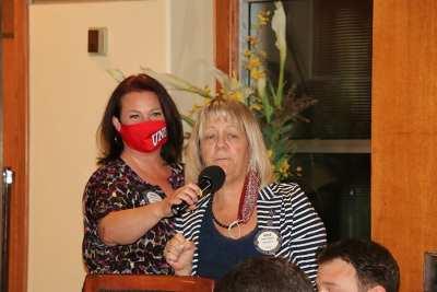 SAA Sara Thornton brings the mic to 25 club president Rose Falocco