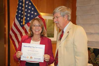 Guest speaker Annette Logan Parker receives a Share What You Can award