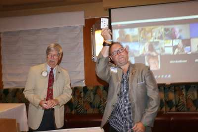 Visiting former Rotarian Jay Ludwig tries for the joker,wins $10.00