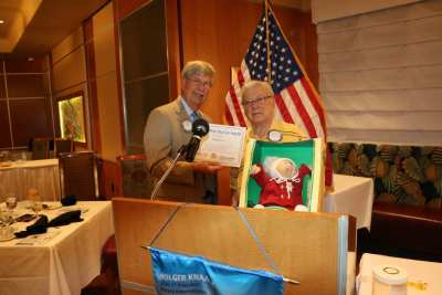 Bert Reiner receives an award for his Cabbage Patch Kid Story