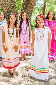 Women in traditional dress at an Arete Guazu event