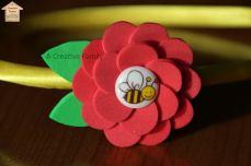 A Creative Family - Cerchietto in raso giallo con fiore