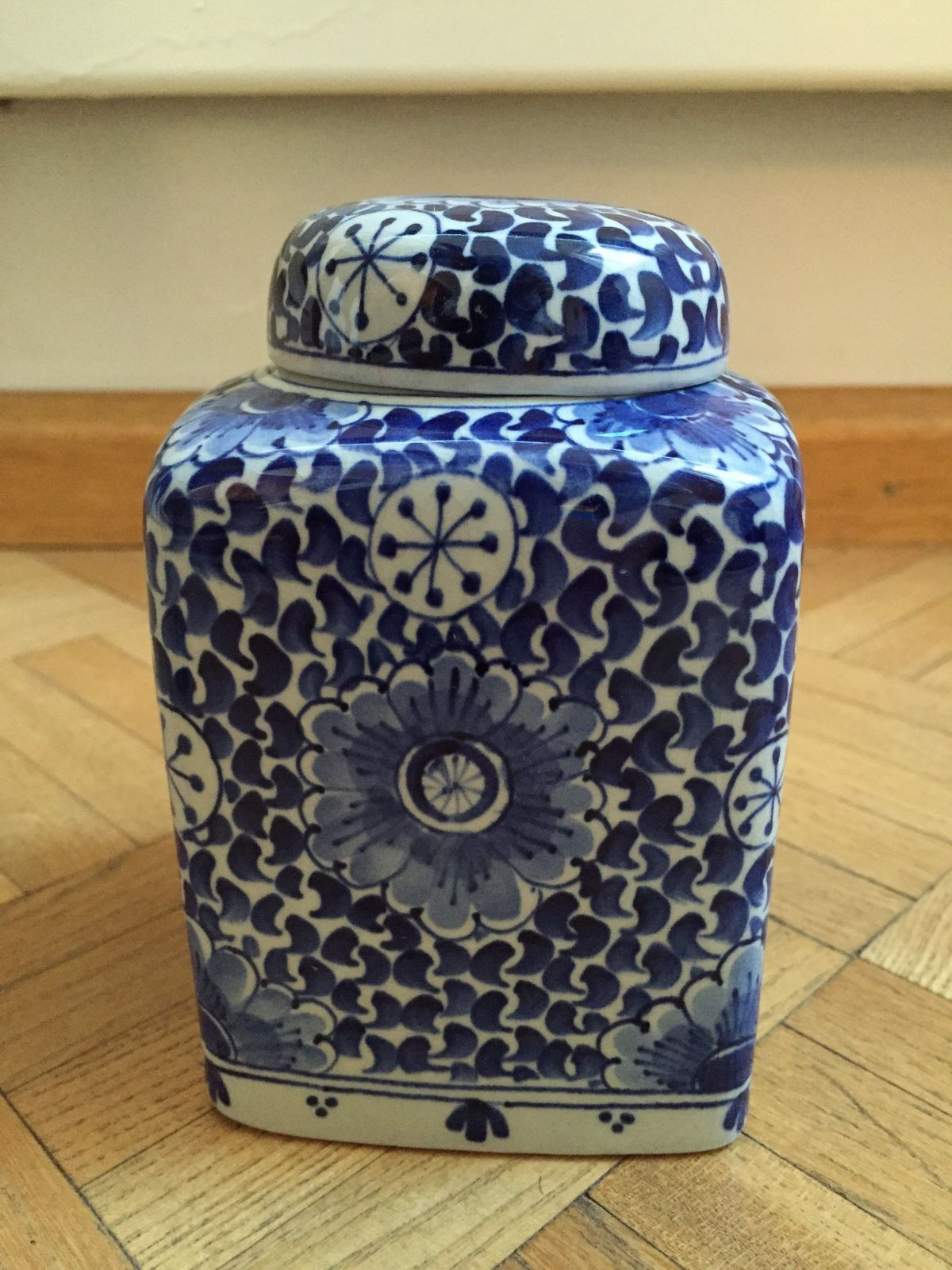 white and blue Delft jar