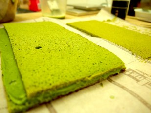 Layering up the Joconde sponge with green tea ganache