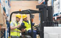 Forklift driver warehouse worker