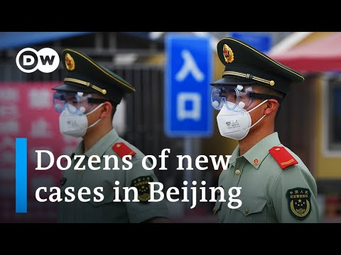 Beijing on partial lockdown after new coronavirus cluster emerges   DW Information