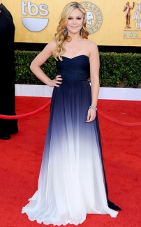 Julia Stiles: Came back to the runway last year looking gorg! Wearing a Monique Lhullier navy and white ombre gown. {Photo: Jon Kopaloff/FilmMagic}