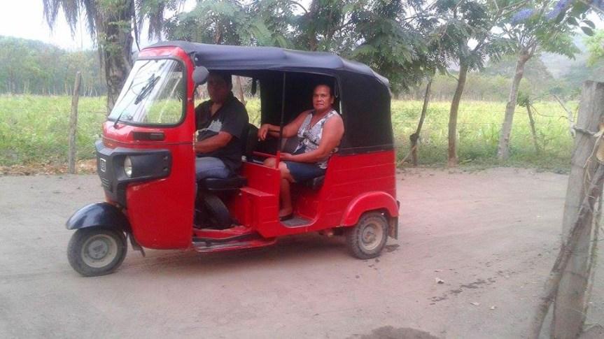 Gloria catches a ride in a moto-taxi.