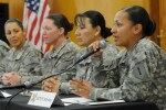 "Sgt. Michallie Wesley, an operations noncommissioned officer in B Company, Brigade Special Troops Battalion, 2nd Advise and Assist Brigade, 1st Infantry Division, United States Division-Center, answers a question as a panelist taking part in an interactive discussion on the theme of ""Women Serving in Combat"" at Camp Liberty, Iraq, Wednesday, March 16, 2011 (U.S. Army photo by Sgt. Jennifer Sardam) (released)"