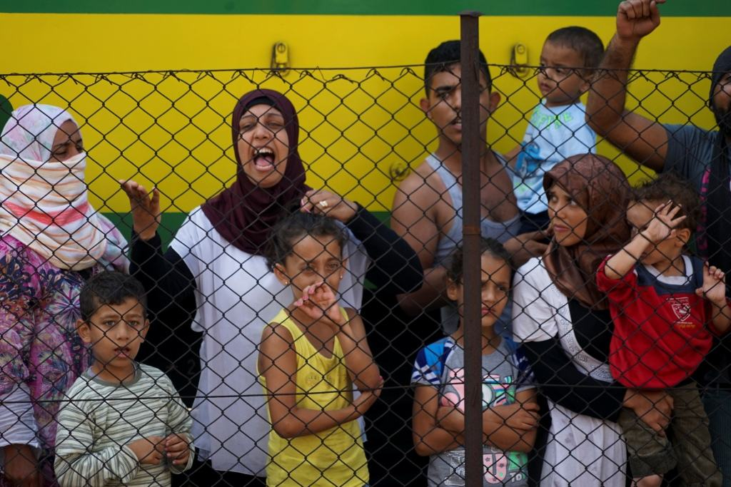 Women and children among Syrian refugees striking at the platform of Budapest Keleti railway station. Refugee crisis. Budapest, Hungary, Central Europe, 4 September 2015. (Wiki Commons)