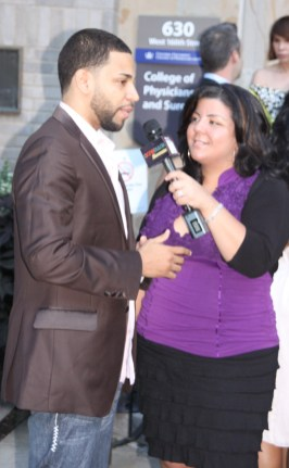 Henry Santos of Aventura giving an interview