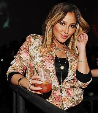 Adrienne Bailon enjoys a Hennessy mixed drink