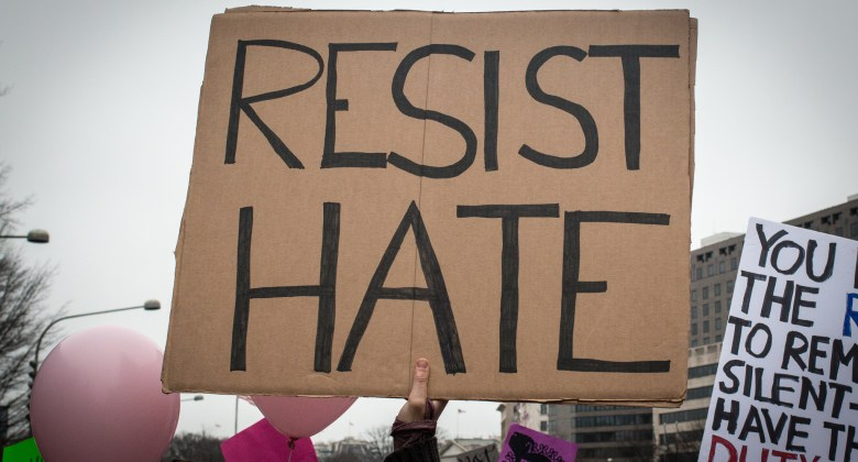 signs says Resist Hate