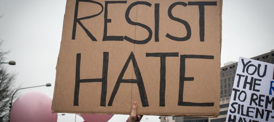 signs says Resist Hate