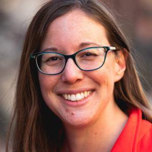 Headshot of Sarah Cassell wearing blue glasses