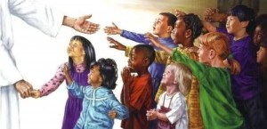 children reaching for Jesus
