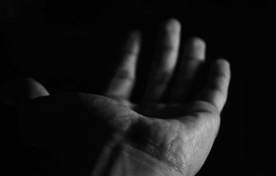 Hand in the dark.