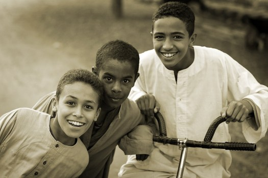 A photo of three smiling young fellows.