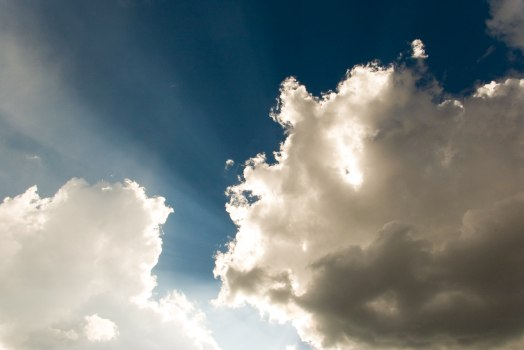 sun streaming through clouds