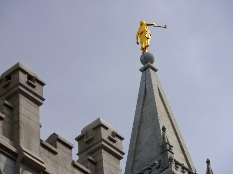 angel moroni on the top of a temple