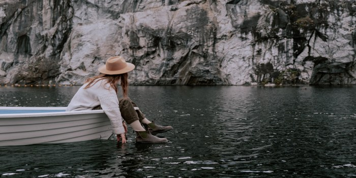 Girl floating in boat on water