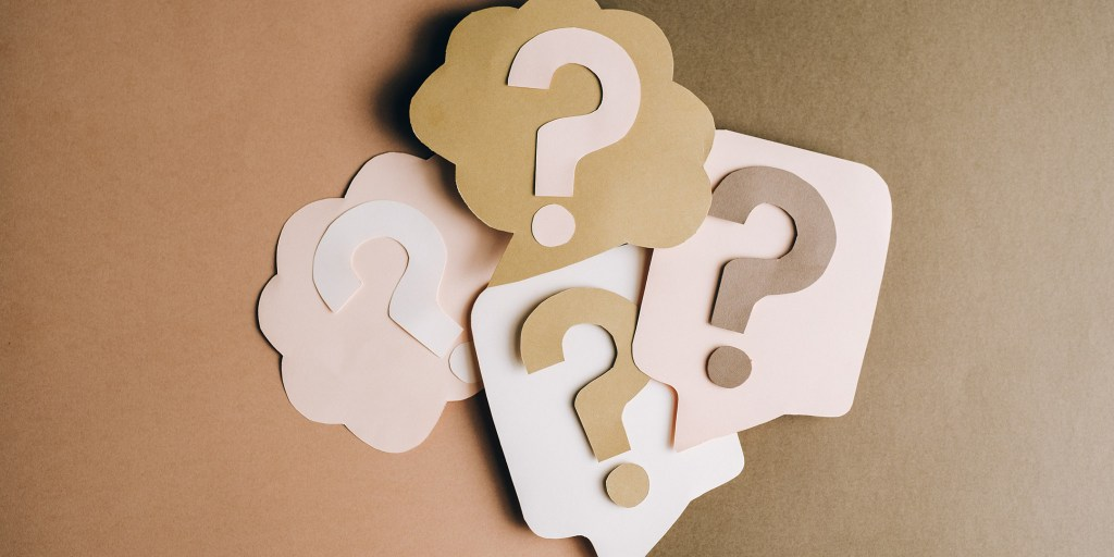 Question marks on colored paper
