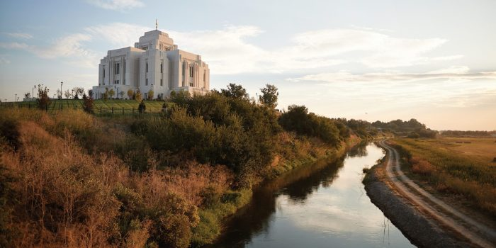 A view of the Meridian Idaho Temple and the Boise River at sunset.