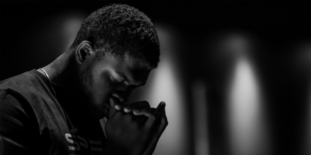 Black and White photo of a man praying