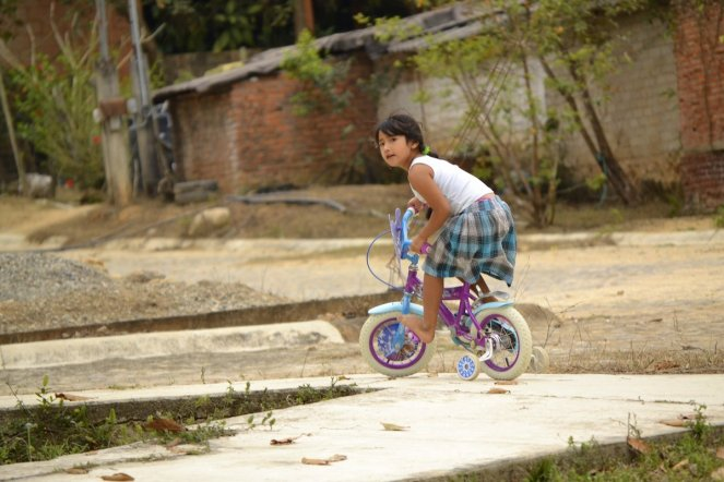 Girl riding her bicycle