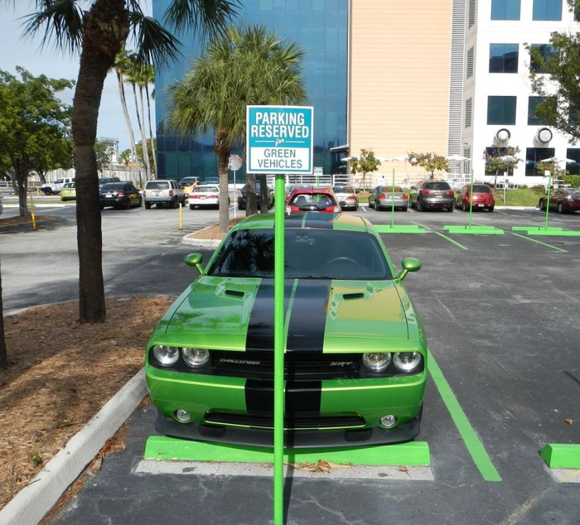 Green vehicles parking only