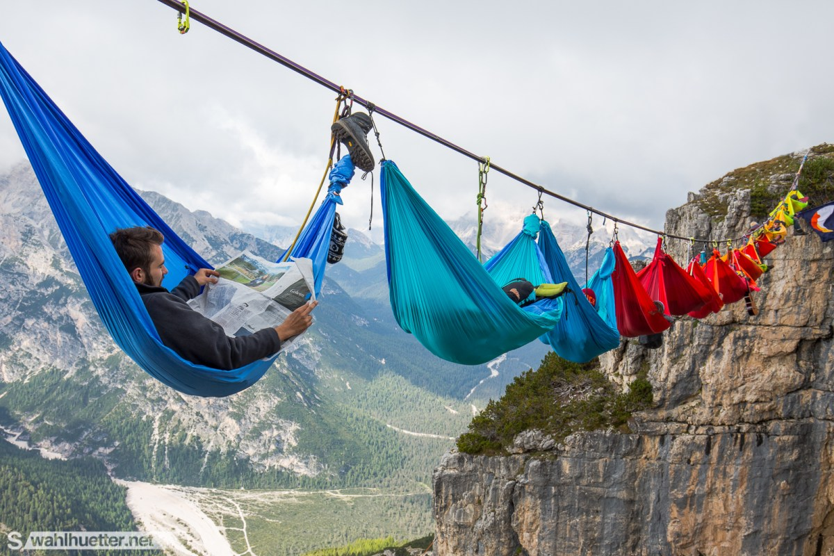 Adventurous Relaxers Set up a Chain of Hammocks Hundreds