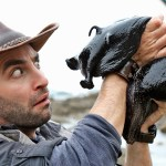 Wilderness Expert Coyote Peterson Picks Up a Giant Black Slug That's the Size of a Small Dog