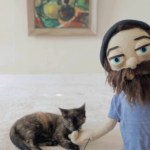 A Tiny Kitten Plays With a Singing Puppet Version of Aesop Rock in Video for a Song About His Cat