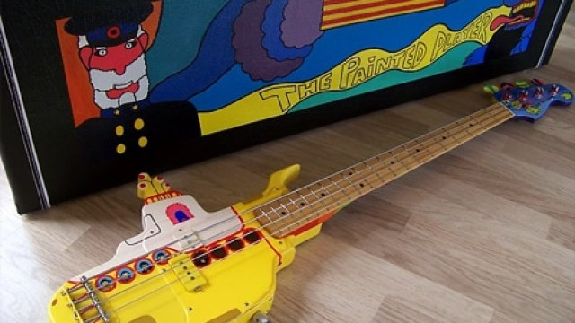 A Magnificently Detailed Custom Bass Guitar Made In The Shape Of Beatles Yellow Submarine