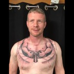 Trucker Gets Hilarious Chest Tattoo That Makes It Look Like He's a Tiny Man Driving His Own Body