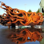 Artist Uses a Chainsaw to Transform a Fallen Redwood Tree Into a Stunning Giant Pacific Octopus