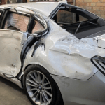Russian Auto Body Mechanic Demonstrates How He Completely Restored a Totaled BMW 7 Series Sedan