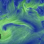 A Mesmerizing Animated Interactive Map Visualizing Global Wind Patterns in Calming Blues and Greens