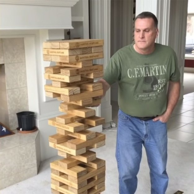 amazing-jenga-move A Man Successfully Yanks a Single Wooden Block From the Middle of the Giant Jenga Stack Random