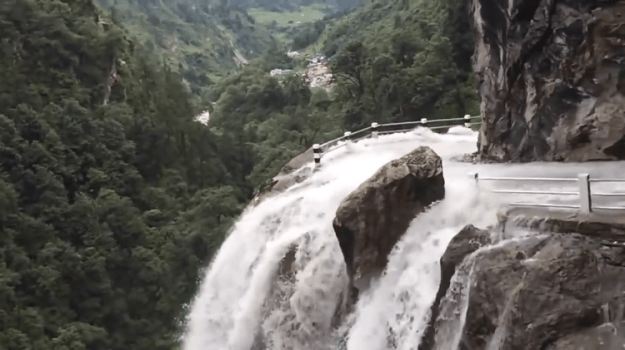 waterfall-road Driver Expertly Navigates a Gorgeous But Perilous Nepalese Road That Runs Through a Waterfall Random