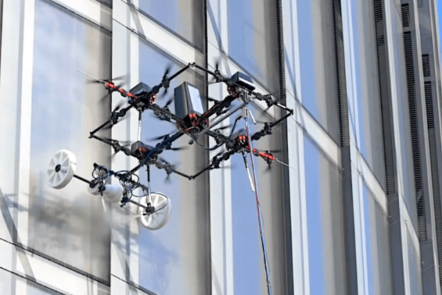 Aerones-Window-Washer-Drone Heavy Duty Tethered Cleaning Drones That Safely Wash Windows of High Altitude Skyscrapers Random