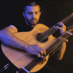 A Beautiful Cover of 'While My Guitar Gently Weeps' Performed on Acoustic Guitar With an Attachable Slide
