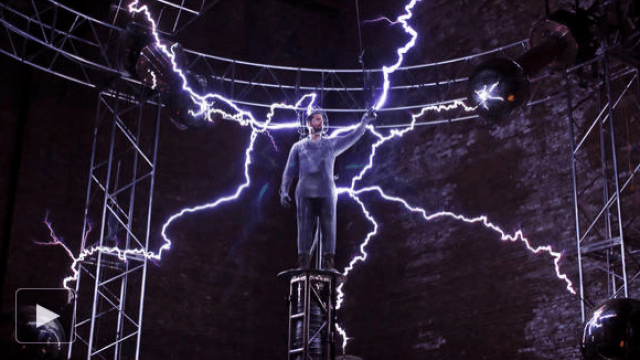 quadrotor in a faraday cage flies between two tesla coils
