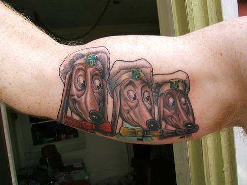 an amazing tattoo inked on his right arm of all three Doggie Diner dog