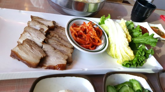 My friend's Naengmyeon and Bossam, steamed sliced pork, combo.