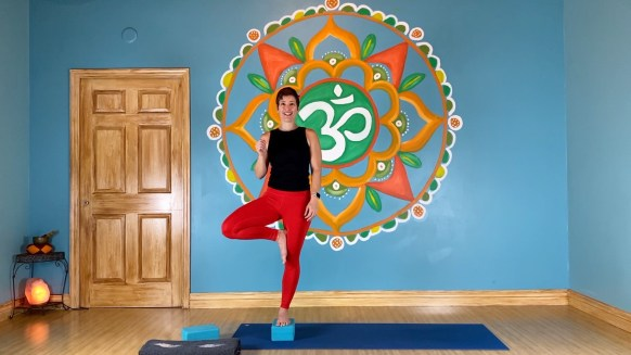 Laura Wenger in a relaxed vrkasana  (tree pose) in the yoga studio in Stuart, Florida